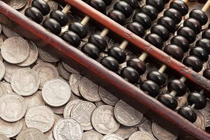 Accounting abacus on money